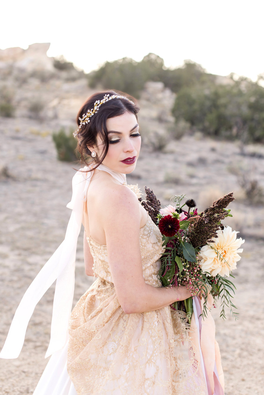 wedding planning photography styled shoot natural light outdoor elopement engagement New Mexico Albuquerque mountains Perfect Wedding Guide headpiece makeup hair updo smoky eye gold neutral bouquet lace high neck greenery bold lip gold details dress